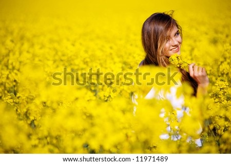 Young nice woman going away and looking back - stock photo
