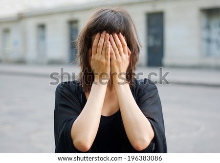 Young nice woman with hidden face - stock photo