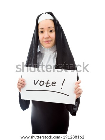 Young nun showing vote sign on white background - stock photo