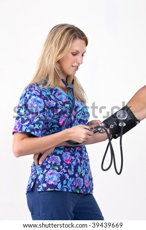 Young nurse, doctor or intern taking a patients blood pressure - stock photo