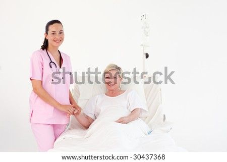 Young Nurse helping a senior patient - stock photo