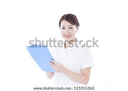 Young nurse holding chart, isolated on white background - stock photo