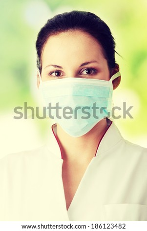 Young nurse in mask - stock photo