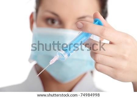 Young nurse in mask with syringe, isolated on white background - stock photo