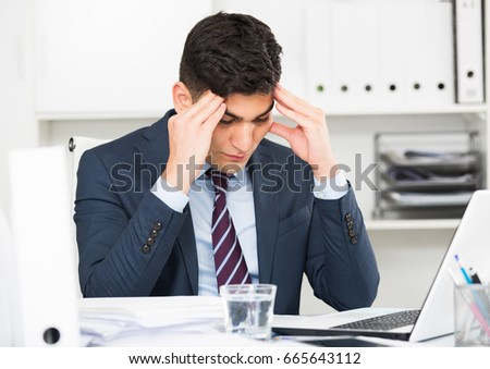 Young office manager is having complicated issue in project in office