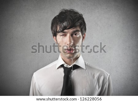 Young office worker squinting one eye - stock photo