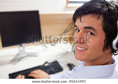 Young operator using a computer at work - stock photo