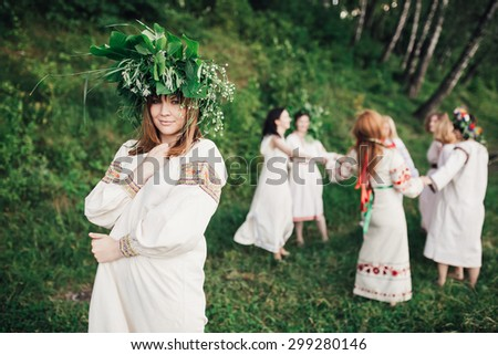 Young pagan Slavic girl conduct ceremony on Midsummer - stock photo