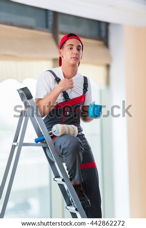 Young painter painting the ceiling in construction concept - stock photo