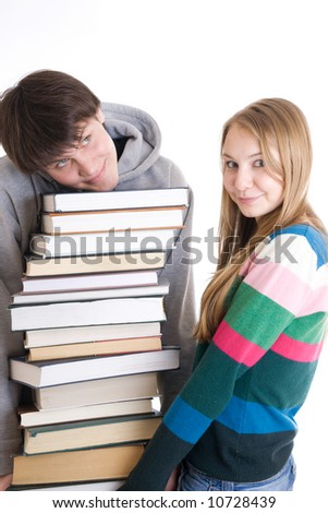 Young pair students with a pile of books isolated on a white background - stock photo