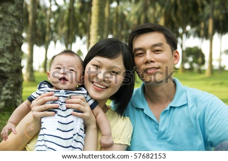 young parents and baby boy - stock photo