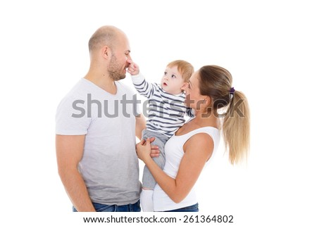 Young parents with their  sweet  child play on a white background. Happy family. - stock photo