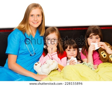 Young pediatrician taking care of her sick little patients. - stock photo