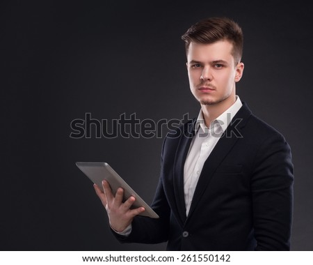 Young Pensive Businessman With Tablet Computer - stock photo