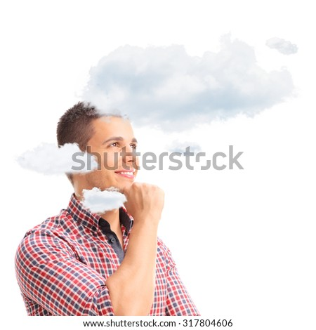 Young pensive man thinking with his head in clouds isolated on white background - stock photo