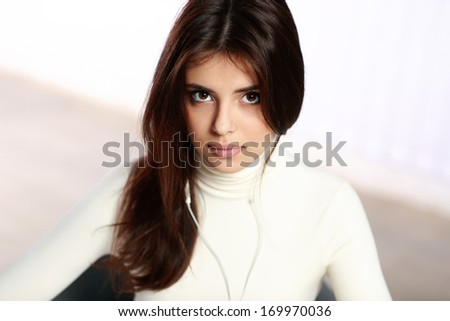 Young pensive student studying at the table - stock photo