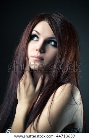 Young pensive woman fashion portrait. - stock photo