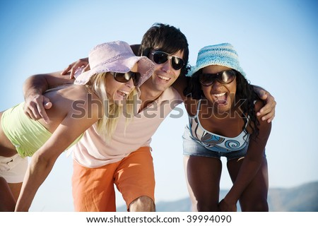 young people at the beach having fun - stock photo