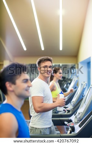 Young people at treadmill  - stock photo