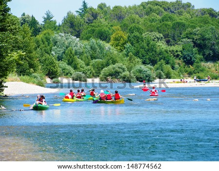 Young people boating on river, peacefull nature scene, Provence, France - stock photo