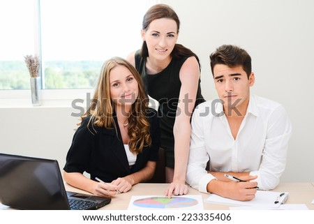 young people business team working together in a meeting room - stock photo