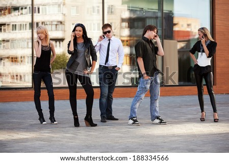 Young people calling on the cell phones - stock photo