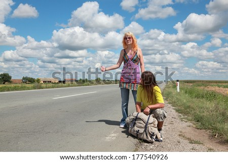 Young people, Caucasian girl and boy  hiking at a road - stock photo