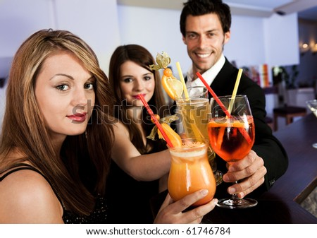 Young people celebrating in the nightclub - stock photo