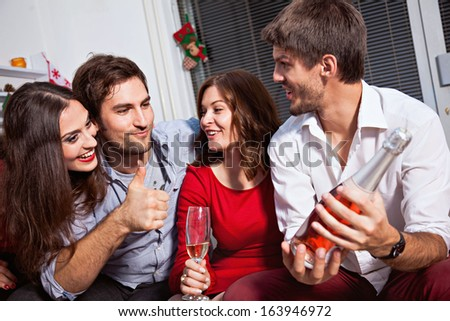 Young people celebrating new year and drinking champagne. - stock photo