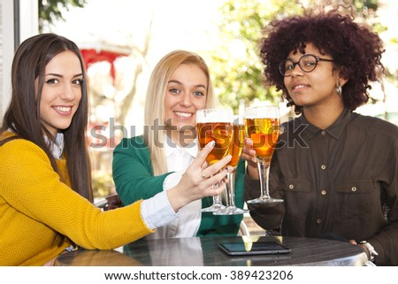 young people celebrating with beer
