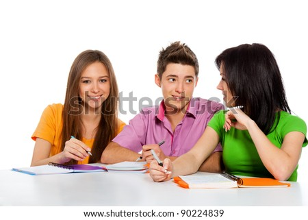 young people communicating discussing, smile beautiful girl looking at camera, three students sitting at the desk, isolated over white background - stock photo