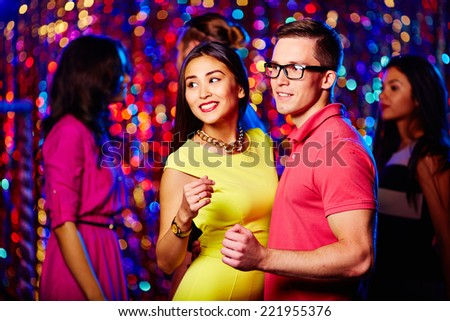 Young people dancing at disco party - stock photo