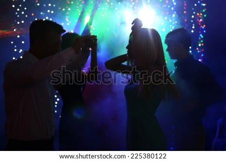 Young people dancing at party  - stock photo