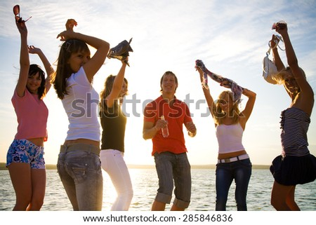 Young People Dancing at Summer Beach Party - stock photo