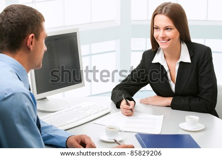 Young people discussing business plan at meeting - stock photo
