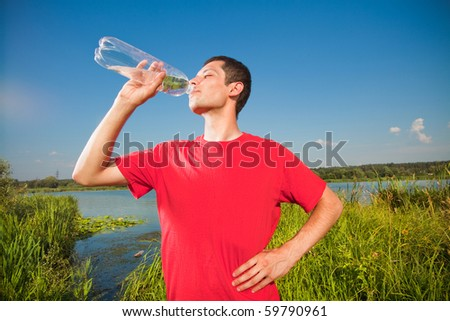 young people drink water from a bottle - stock photo