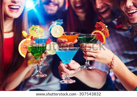 Young people drinking cocktails at nightclub - stock photo