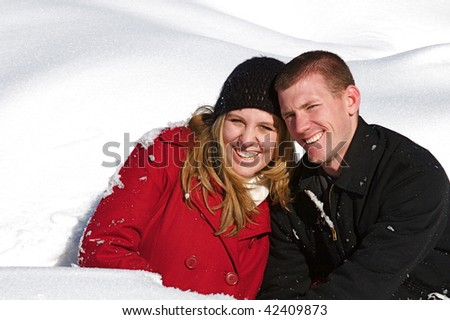 Young people enjoy a fresh snow fall