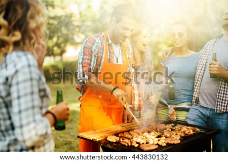 Young people enjoying barbecuing - stock photo