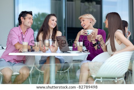 Young people enjoying coffee break - stock photo
