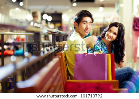 Young people enjoying the break between shopping sessions - stock photo