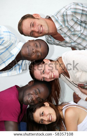 young people from different backgrounds have fun together and look towards the camera - stock photo