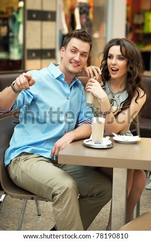 Young people having fun at lunch in shopping mall - stock photo