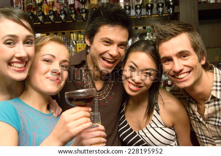 Young people in a bar - stock photo