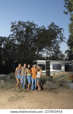 Young People in Front of Camper in Countryside - stock photo
