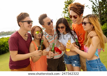 Young people in sunglasses drinking at the party