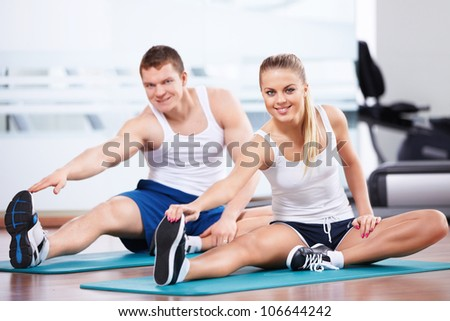 Young people in the fitness club - stock photo