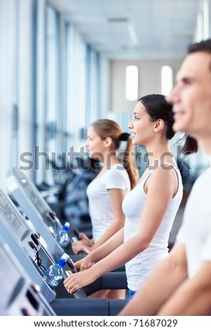Young people involved in fitness - stock photo