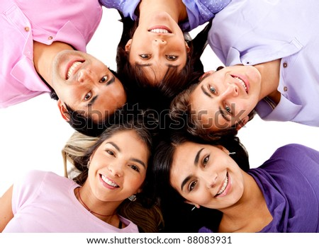 Young people lying on the floor making a circle of friends - stock photo