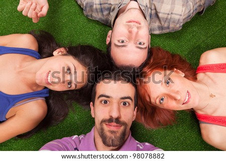 Young People Lying on the Ground - stock photo